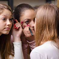 Women putting on makeup, click to read more