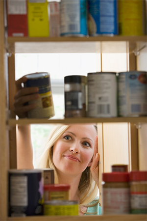 Picture of woman looking into cabinet