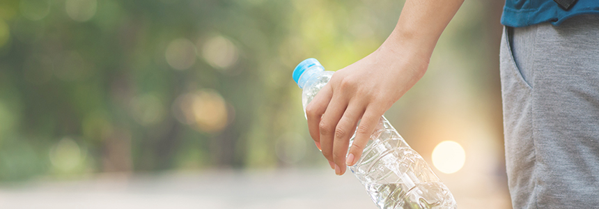 Person holding bottled water